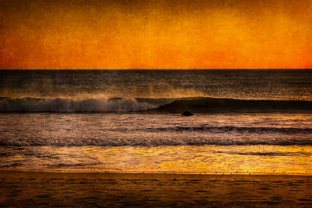breaking wave with firery sky SoCal Seascapes