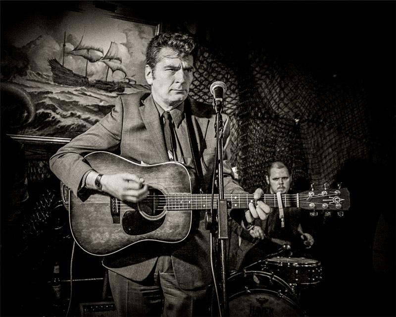 Singer songwriter Skip Heller onstage at The Redwood Bar