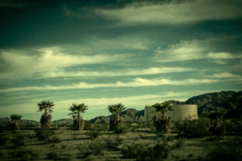 twentynine palms trees water tank mojave clouds